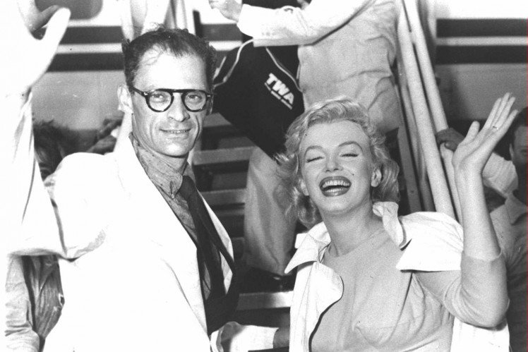 arthur-miller-and-his-wife-actor-marilyn-monroe-1926-1962-wave-as-they-board-a-plane-circa-1956-they-were-married-for-five-years